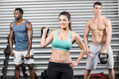 Fit people lifting dumbbells stock images