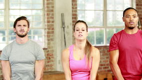 Fit people lifting kettlebells together stock video
