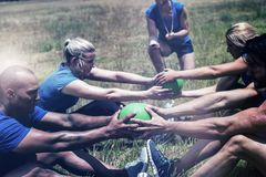 Fit people performing core exercise. In bootcamp royalty free stock images