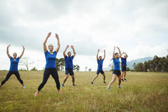 Fit people performing stretching exercise Royalty Free Stock Photography