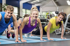 Fit people in plank position Royalty Free Stock Photo