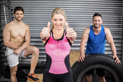 Fit people posing with thumbs up Stock Photography