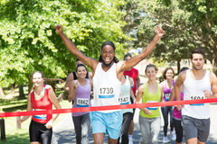 Fit people running race in park Stock Photography
