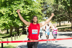 Fit people running race in park. On a sunny day Stock Photos