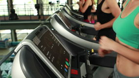 Fit people running on treadmill. At the gym stock video