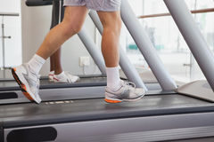 Fit people running on treadmills Royalty Free Stock Images