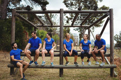Fit people sitting on the obstacle couse. In bootcamp Royalty Free Stock Photography