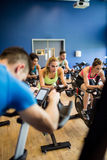 Fit people in a spin class. At the gym royalty free stock image