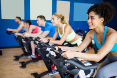 Fit people in a spin class. At the gym stock photography