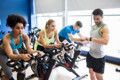 Fit people in a spin class Stock Photography