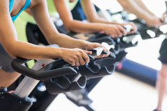 Fit people in a spin class. At the gym royalty free stock photography