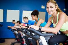 Fit people in a spin class. At the gym Stock Image