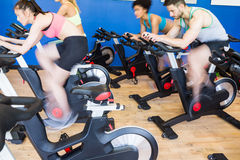 Fit people in a spin class. At the gym Stock Photos