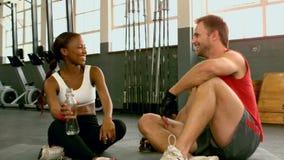 Fit people taking a break in gym. In slow motion stock video