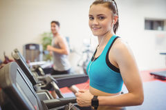 Fit people using the treadmill Stock Images