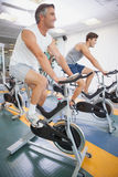 Fit people working out on the exercise bikes Royalty Free Stock Image
