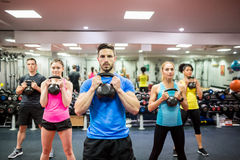 Fit people working out in fitness class. At the gym Royalty Free Stock Image