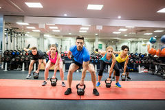 Fit people working out in fitness class stock image