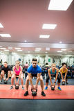 Fit people working out in fitness class Stock Images