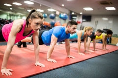 Fit people working out in fitness class Stock Photography