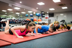 Fit people working out in fitness class Royalty Free Stock Images