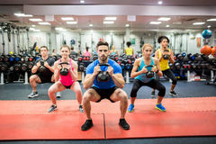 Fit people working out in fitness class Stock Photo