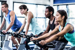 Fit people working out at spinning class Stock Photo