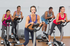 Fit people working out at spinning class Royalty Free Stock Images