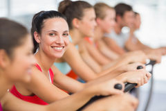 Fit people working out at spinning class Royalty Free Stock Image