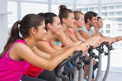 Fit people working out at spinning class Royalty Free Stock Photos