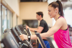 Fit people working out using machines Stock Image