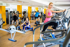 Fit people working out using machines Stock Images