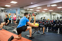 Fit people working out in weights room. At the gym Stock Images