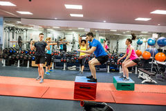 Fit people working out in weights room Royalty Free Stock Photography