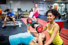 Fit people working out in weights room Stock Photos