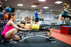 Fit people working out in weights room. At the gym Royalty Free Stock Photo