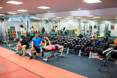 Fit people working out in weights room Stock Photography