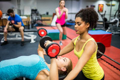 Fit people working out in weights room. At the gym Stock Photography