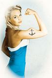 Fit Pin-Up Girl With Big Muscles And Anchor Tattoo. Tough American Style Maritime Pin-Up Girl With Big Muscles And Anchor Tattoo Stock Photos