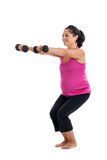 Fit pregnant woman lifting weights Stock Photo