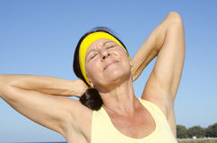Fit and relaxed mature woman sky  Royalty Free Stock Photo