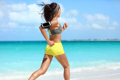Fit runner cardio training doing running workout on beach Stock Images