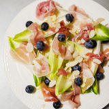Fit salad with prosciutto and endives Royalty Free Stock Photography