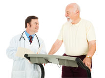 Fit Senior Man Consults Doctor Royalty Free Stock Photography