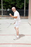 Fit Senior Man Playing Racquetball Royalty Free Stock Photography