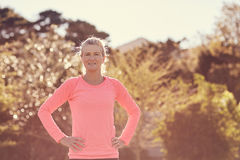 Fit senior woman outdoors on sunlit morning ready for exercise. Portrait of a confident senior woman standing outdoors on a sunlit morning ready for some health Royalty Free Stock Photography