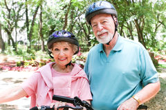 Fit Seniors Ride Bicycles Royalty Free Stock Photography