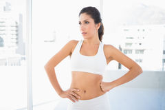 Fit serious woman in sportswear looking away Royalty Free Stock Photos