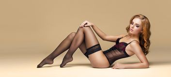 Fit, sexy and attractive woman in sexy lingerie. Blond fashion model posing in beautiful underwear.