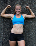 Fit, woman flexing her biceps Stock Photos